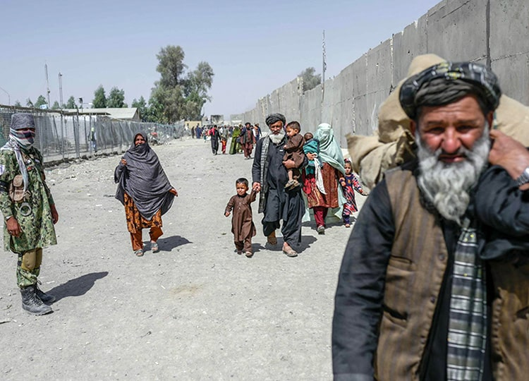People cross into Pakistan at a border checkpoint in Spin Boldak, Afghanistan, on Sept. 25.