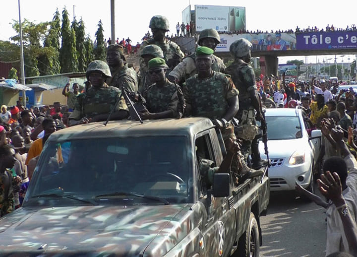 Soldiers detain Guinea's president after firefight, dissolve government