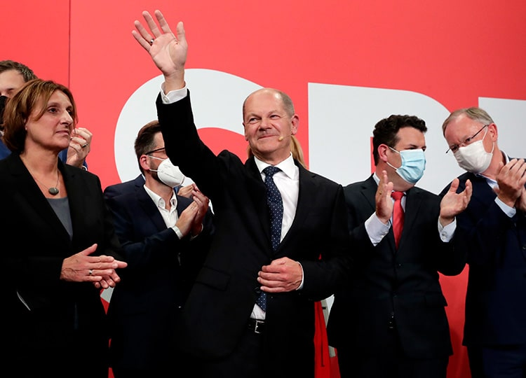 Olaf Scholz, the Social Democratic Party's candidate to be chancellor of Germany, waves to supporters after national elections at SPD headquarters in Berlin on Sept. 26.