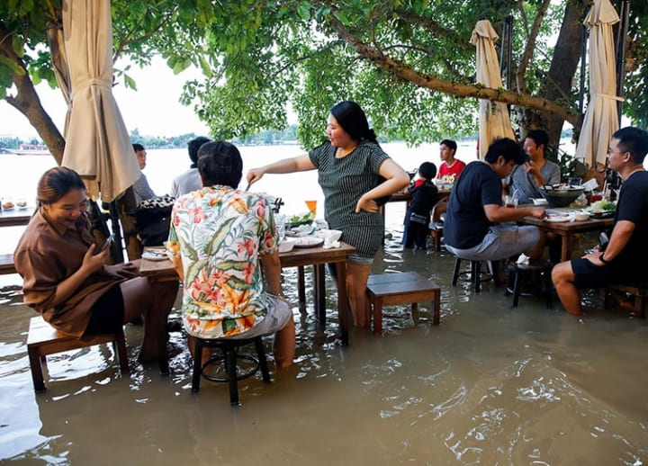 Riverside restaurant makes waves in Thailand as diners come for a meal and a thrill