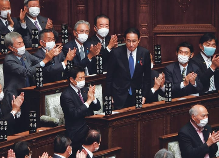 Kishida takes office as Japan PM, calls election for end of October